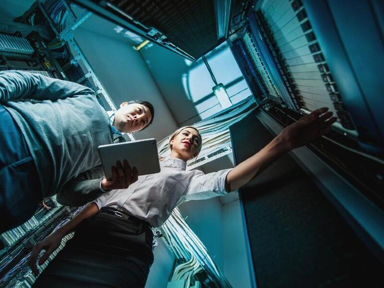 Man and woman working at data center